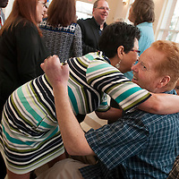 Lee Spearman greets well wishers at Clinton Family Worship Center in Clinton, N.C., March 16, 2014.