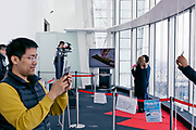 tourists and portrait being taken at the Tokyo sky view indoors observation deck in the Mori Tower