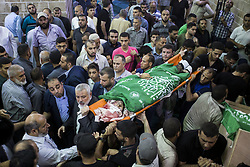 July 26, 2018 - Gaza City, The Gaza Strip, Palestine - Hamas Chief Ismail Haniyeh carries the body of Palestinian Hamas militant Mohammad Al-Areer who was killed in Israeli tank fire, during his funeral in Gaza City July 26, 2018. (Credit Image: © Mahmoud Issa/Quds Net News via ZUMA Wire)