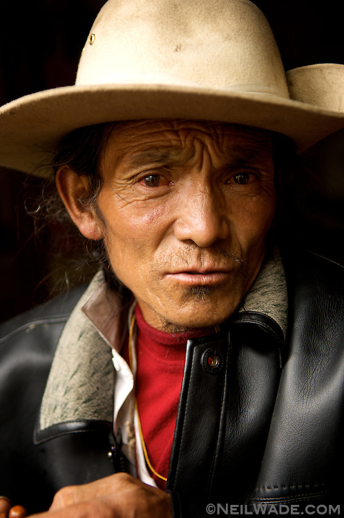A Tibetan cowboy poses for a picture near Lhasa, Tibet (China).