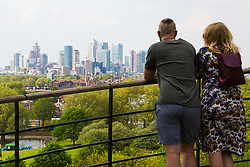 A couple gaze out over Docklands in London from Maze Hill, Greenwich as Mayor Sadiq Khan announces air toxicity alerts for the Capital. London, February 10 2018.