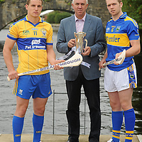 26 July 2010; Tipperary captain Padraic Maher, right, and John Conlon, left, Clare captain with Ger Cunningham, Sports Sponsorship manager Bord Gáis Energy, met halfway on the bridge at Killaloe, Co. Clare and Ballina, Co. Tipperary ahead of Wednesday night's Bord Gáis Energy Munster GAA Hurling U-21 Final. Tipperary will look to upset current Munster and All-Ireland champions Clare on home turf at Semple Stadium, where throw in is at 7.30pm. Killaloe, Co. Clare. Picture credit: David Maher / SPORTSFILE *** NO REPRODUCTION FEE ***