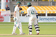 Hassan Azad is congratulated by Colin Ackemann on reaching 50 during the Specsavers County Champ Div 2 match between Leicestershire County Cricket Club and Lancashire County Cricket Club at the Fischer County Ground, Grace Road, Leicester, United Kingdom on 26 September 2019.