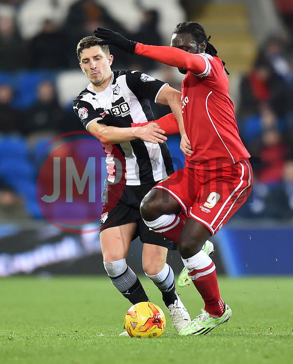 Watford's Craig Cathcart and Cardiff City's Kenwyne Jones compete for the ball - Photo mandatory by-line: Paul Knight/JMP - Mobile: 07966 386802 - 28/12/2014 - SPORT - Football - Cardiff - Cardiff City Stadium - Cardiff City v Watford - Sky Bet Championship