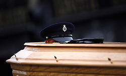 © Licensed to London News Pictures. 22/03/2016. Belfast, Northern Ireland, UK. The hat and gloves of murdered prison officer Adrian Ismay on his coffin following a funeral service at Woodvale Methodist church. Mr Ismay died following a booby-trap bomb that exploded under his van in East Belfast on March 4th. Photo credit: Peter Morrison/LNP