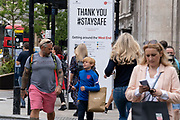 After the announcement that Covid rules are to be relaxed by the government on July 19th, shoppers cross Oxford Circus in the West End, on 8th July 2021, in London, England.
