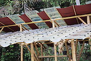 """Recycling 'windscreens' from old vehicles used as glass tiles for greenhouse<br /><br />The Green School (Bali) is one of a kind in Indonesia. It is a private, kindergarten to secondary International school located along the Ayung River near Ubud, Bali, Indonesia. The school buildings are of ecologically-sustainable design made primarily of bamboo, also using local grass and mud walls. There are over 600 students coming from over 40 countries with a percentage of scholarships for local Indonesian students.<br /><br />The impressive three-domed """"Heart of School Building"""" is 60 metres long and uses 2500 bamboo poles. The school also utilizes renewable building materials for some of its other needs, and almost everything, even the desks, chairs, some of the clothes and football goal posts are made of bamboo.<br /><br />The educational focus is on ecological sustainability. Subjects taught include English, mathematics and science, including ecology, the environment and sustainability, as well as the creative arts, global perspectives and environmental management. This educational establishment is unlike other international schools in Indonesia. <br /><br />Renewable energy sources, including solar power and hydroelectric vortex, provide over 50% of the energy needs of the school. The school has an organic permaculture system and prepares students to become stewards of the environment. <br /><br />The school was founded by John and Cynthia Hardy in 2008."""