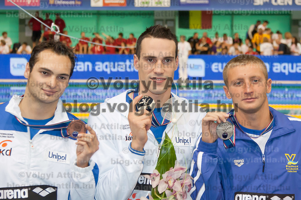 Bronze medalist Mattia Pesce (L) of Italy, gold medalist Fabio Scozoli (C) of Italy and Valery Dymo (R) of Ukraine celebrate their victory in the Men's 100m breaststroke during the 31th European Swimming Championships in Debrecen, Hungary on May 22, 2012. ATTILA VOLGYI