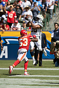 Los Angeles Chargers running back Austin Ekeler (30) leaps and catches a 13 yard touchdown pass that cuts the Kansas City Chiefs second quarter lead to 14-12 while covered by Kansas City Chiefs linebacker Anthony Hitchens (53) during the 2018 regular season week 1 NFL football game against the Kansas City Chiefs on Sunday, Sept. 9, 2018 in Carson, Calif. The Chiefs won the game 38-28. (©Paul Anthony Spinelli)