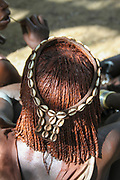 Closeup of the head and hair of a Hamer Tribeswoman. The hair is coated with ochre mud and animal fat. Photographed in the Omo River Valley, Ethiopia