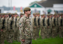 © Licensed to London News Pictures. 10/07/2012..Harrogate, England...Soldiers from the 1st Battalion The Yorkshire Regiment exercise the Freedom of Harrogate with a march past at the Great Yorkshire Show after recently returning from Afghanistan...England's premier agricultural show opened it's gates today for the start of three days of showcasing the best in British farming and the countryside...The event, which attracts over 130,000 visitors each year is the 154th show and displays the cream of the country's livestock and offers numerous displays and events and gives the chance to see many different countryside activities...Photo credit : Ian Forsyth/LNP
