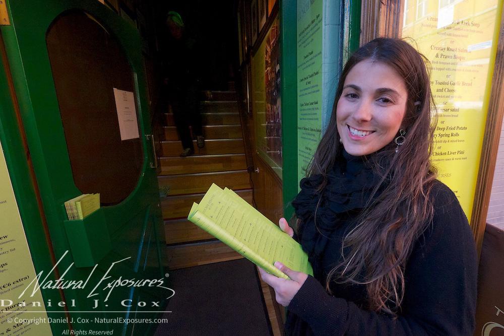 Daniella greets visitors to the The Old Mill pub in Dublin, Ireland.