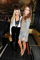 Left to right, ZARA MARTIN and JADE WILLIAMS at the Johnnie Walker Gold Label Reserve Launch Party at Whisky Mist, 35 Hertford Street, London on 18th July 2012.
