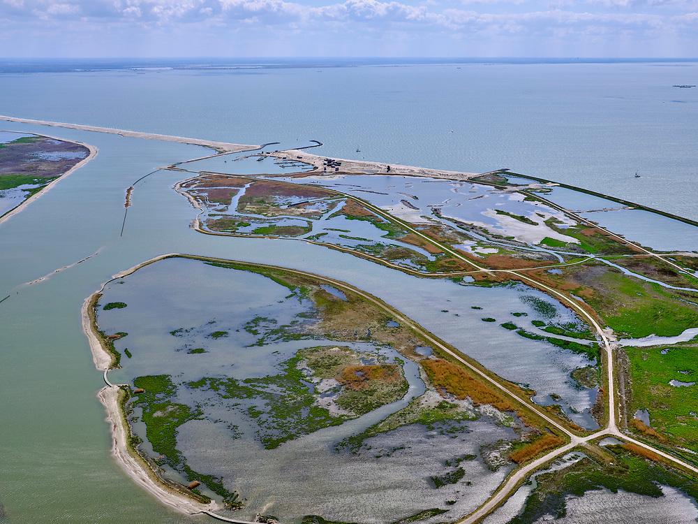 Nederland, Flevoland, Markermeer, 07-05-2021; Marker Wadden in het Markermeer. Gezien naar Zuidwesten.<br /> Doel van het project van Natuurmonumenten en Rijkswaterstaat is natuurherstel, met name verbetering van de ecologie in het gebied, in het bijzonder de kwaliteit van bodem en water. De Marker Wadden archipel bestaat momenteel uit vijf eilanden, twee nieuwe eilanden zijn in ontwikkeling.<br /> Marker Wadden, artifial islands. The aim of the project is to restore the ecology in the area, in particular the quality of soil and water.<br /> The Marker Wadden archipelago currently consists of five islands, two new islands are under development.<br /> luchtfoto (toeslag op standard tarieven);<br /> aerial photo (additional fee required)<br /> copyright © 2021 foto/photo Siebe Swart