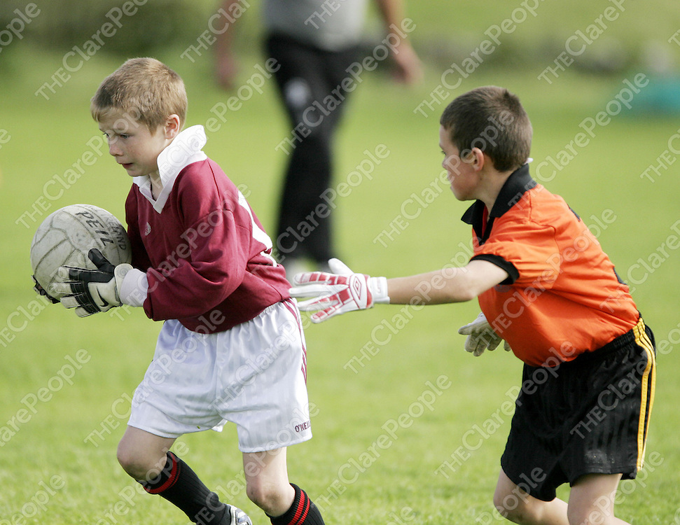 St. Breckans Aiden Davidson tries to hold off Ballyvaughan's Ronan Fahy during the Michael Greene Memorial Cup at the weekend.<br /> <br /> Photograph by Yvonne Vaughan.