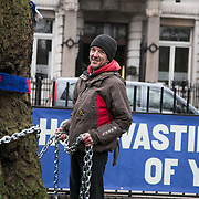 Protest against the HS2 project at Euston station. The high speed train line prject from London to Birmingham will take 17 years to complete and cost an estimated £100b. Locals in Camden staged a protest to highlight this fact in an attempt to stop the project. Vicar Anne Stevens and local resident Jo Hurford chained themselves to one of the many trees which will be cut down by HS2 to make way for the new train station.
