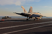 A Boeing F/A-18C Hornet, AC 200 164889 from VMFA-312 'Checkerboards' catches the arresting gear on the deck of CVN-75 USS Harry S. Truman after a mission..