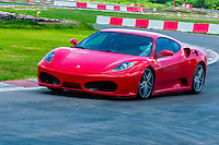 Ferrari F430 on the track at Exotic Rides Mexico. Exotic Rides Mexico gives guests the opportunity to drive the most exotic and exclusive cars in the world on a 1.1 mile private race track in Cancun, Quintana Roo, Mexico.