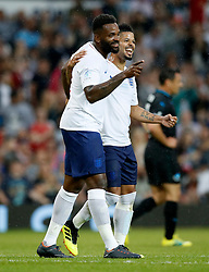 England's Darren Bent (left) celebrates scoring his side's first goal of the game during the UNICEF Soccer Aid match at Old Trafford, Manchester.
