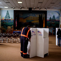 Voters fill out their ballots at the polling place in the Cibola County complex in Grants Tuesday.