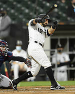 CHICAGO - APRIL 12:  Adam Eaton #12 of the Chicago White Sox hits a three run home run in the third inning against the Cleveland Indians on April 12, 2021 at Guaranteed Rate Field in Chicago, Illinois.  (Photo by Ron Vesely) Subject:  Adam Eaton