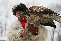 JILIN, Dec. 22, 2016  During a local tourism festival, a hunter presents his goshawk in Jilin City of notheast China's Jilin Province, Dec. 22, 2016. Hunting with eagles is a traditional form of falconry among local ethnic groups.  lb) (Credit Image: © Cai Yang/Xinhua via ZUMA Wire)