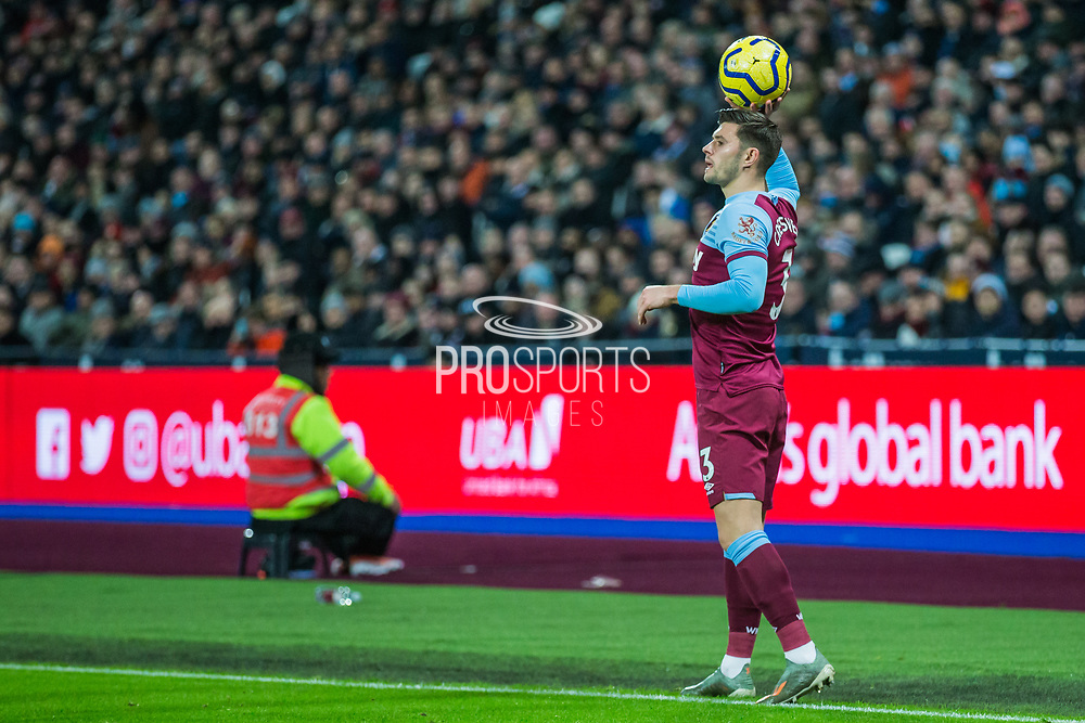 Aaron Cresswell (West Ham) with a throw in during the Premier League match between West Ham United and Arsenal at the London Stadium, London, England on 9 December 2019.