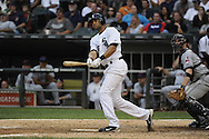 CHICAGO - SEPTEMBER 10:  Alex Rios #51 of the Chicago White Sox hits a walk-off grand slam home run in the bottom of the tenth inning off of Chris Perez #54 of the Cleveland Indians on September 10, 2011 at U.S. Cellular Field in Chicago, Illinois.  The White Sox defeated the Indians 7-3.  (Photo by Ron Vesely)   Subject: Alex Rios;Chris Perez