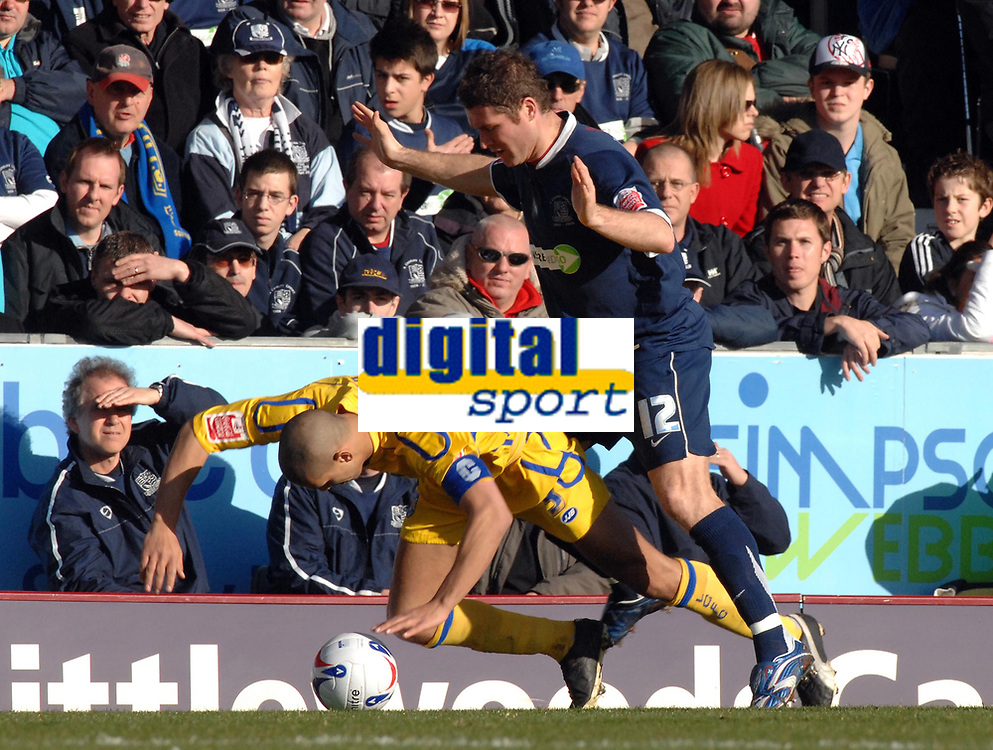 Photo: Ashley Pickering.<br />Southend United v Leicester City. Coca Cola Championship. 03/03/2007.<br />Leicester captain Patrick Kisnorbo (L) is shoved to the floor by Lee Bradbury of Southend