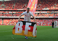Football - 2017 / 2018 Premier League - Arsenal vs. Burnley<br /> <br /> Per Mertesacker of Arsenal with his 'BIG F--KING GERMAN' flag after his last game, at The Emirates.<br /> <br /> COLORSPORT/ANDREW COWIE