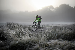 © Licensed to London News Pictures. 08/11/2019. London, UK. A man cycles through a fog covered landscape at Richmond Park in west London on cold morning. Parts of the north of England have experienced severe flooding following torrential rainfall. Photo credit: Ben Cawthra/LNP