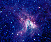 A star-making cloud called M17, or the Swan nebula. Located about 6,000 light-years away in the constellation Sagittarius. Spitzer Space Telescope.