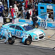The pit crew changes tires on the car of Danica Patrick (10) during the 58th Annual NASCAR Daytona 500 auto race at Daytona International Speedway on Sunday, February 21, 2016 in Daytona Beach, Florida.  (Alex Menendez via AP)