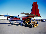 Fire extinguishers being off-loaded from Troy Air's CASA C212 Aviocar built in Spain, Bettles Field, Alaska.