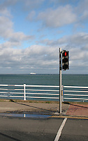 Seafront at DunLaoghaire in Dublin Ireland, stormy day in winter, car ferry arriving in the distance