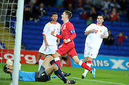 Aaron Ramsey of Wales celebrates after scoring. Euro 2012 Qualifying match, Wales v Montenegro at the Cardiff City Stadium in Cardiff  on Friday 2nd Sept 2011. Pic By  Andrew Orchard, Andrew Orchard sports photography,