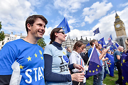 © Licensed to London News Pictures. 09/09/2017. London, UK. Anti-Brexit protesters wave banners and flags in Parliament Square during the People's March for Europe rally campaigning for the UK's continued membership of the European Union. Photo credit : Stephen Chung/LNP