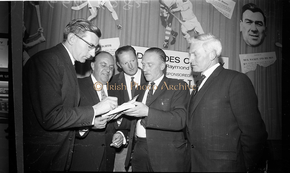"""17/05/1966<br /> 05/17/1966<br /> 17 May 1966<br /> Book reception for """"Decades of Glory: A Comprehensive History of the National Game"""" by Raymond Smith.<br /> This reception was held in the offices of W.D. & H.O. Wills to honor the well known author and journalist, Raymond Smith. His book on the history of Hurling (""""Decades of Glory"""") has just been published with the assistance of Wills of Dublin and Cork and the Central Council of the G.A.A.<br /> Picture shows (from left to right): Raymond Smith (author), Mr Westropp Irvine (Factory Manager for Wills of Dublin and Cork), Billy Rackard (a famous Wexford hurler), Pat O'Neill, and Sean Duggan (Galway)."""