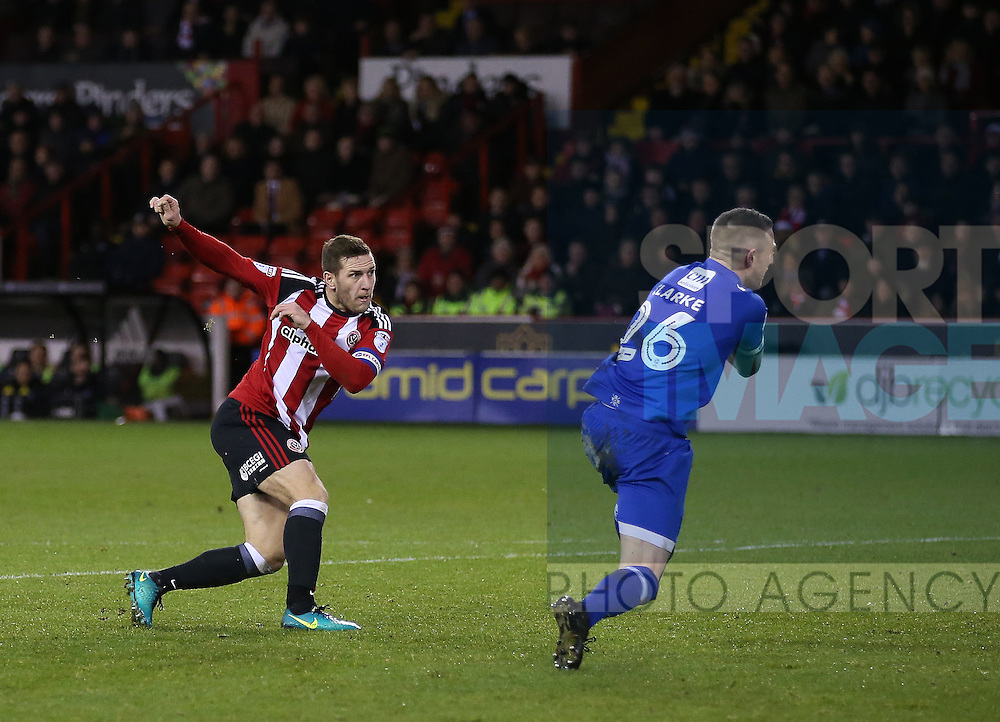 Billy Sharp of Sheffield Utd sweeps home the second goal during the English League One match at Bramall Lane Stadium, Sheffield. Picture date: December 26th, 2016. Pic Simon Bellis/Sportimage