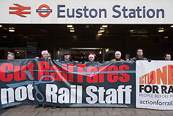 © licensed to London News Pictures. London, UK 11/12/2012. Rail union members Joined by General Secretary of the RMT Bob Crowe demonstrate Outside Euston Railway Station in London over  escalating fare rises. There were protests at Euston, King's Cross, Paddington and Eltham, as research was released showing that average rail fares have risen nearly three times faster than wages since the recession began. Photo credit: Tolga Akmen/LNP