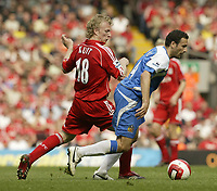 Photo: Aidan Ellis.<br /> Liverpool v Wigan Athletic. The Barclays Premiership. 21/04/2007.<br /> Liverpool's Dirk Kuyt (L) chases Wigan's Josip Skoko