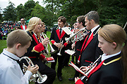 The Hardraw Scaur Brass Band Festival. Members from the Tingley band prepare to join the massed band performance. Organised by the Yorkshire and Humberside Brass Band Association, the competition is Britain's second oldest outdoor contest and takes place annually in Hardraw Scar in Wensleydale, North Yorkshire, England, UK. The area, a natural amphitheatre, attracts bands from all over the North of England and is a popular event amongst players and audiences alike.