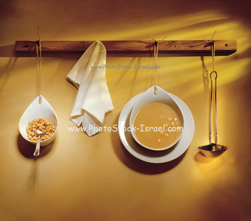 Bowl of soup and Croutons hanging on the wall