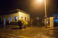 Horse and cart on a rainy night in Gibara, Holguin, Cuba.