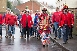 """© Licensed to London News Pictures. 06/01/2016. Haxey UK. Picture shows Dale Smith """"the fool"""" at The Haxey Hood that takes place today, The historic event dating back to the 14th century sees teams representing four pubs in Haxey & Westwoodside compete for a leather cylinder known as the hood. After a pub crawl around the participating pubs, the game begins with a famous speech from the ceremonial fool. The game is won when the scrum reaches one of the pubs and the hood is touched by the landlord or landlady. Photo credit: Andrew McCaren/LNP"""