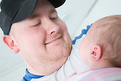 Portrait of a man with his new born baby,