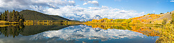 """Oxbow Bend Autumn Panorama.  A beautiful morning in Grand Teton National  Park, a windless morning fosters a reflection of autumn color and the Grand Tetons upon the calm water of the Snake River. <br /> <br /> This is a huge image and can be printed ten feet wide if you have a large space to fill. This is a 4X1 ratio 325 megabyte file. This website doesn't provide a 4X1 printing option.  Contact me directly for custom order. dh@greater-yellowstone.com, 208-709-3250<br /> <br /> For production prints or stock photos click the Purchase Print/License Photo Button in upper Right; for Fine Art """"Custom Prints"""" contact Daryl - 208-709-3250 or dh@greater-yellowstone.com"""