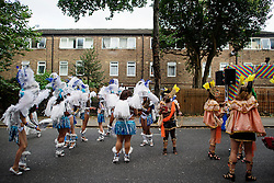 © Licensed to London News Pictures. 29/08/2016. London, UK. Carnival goers in costume wait in the streets to take part in  day two of the Notting Hill carnival, the second largest street festival in the world after the Rio Carnival in Brazil, attracting over 1 million people to the streets of West London.  Photo credit: Ben Cawthra/LNP