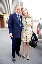 SIMON DE PURY and Michaela Neumeister at the Montblanc de la Culture Arts Patonage Award 2010 held at Floors 7-10, Multi-Storey Car Park, 95A Rye Lane, London SE15 on 30th June 2010.  The 2010 UK winners were Yana Peel & Candida Gertler.