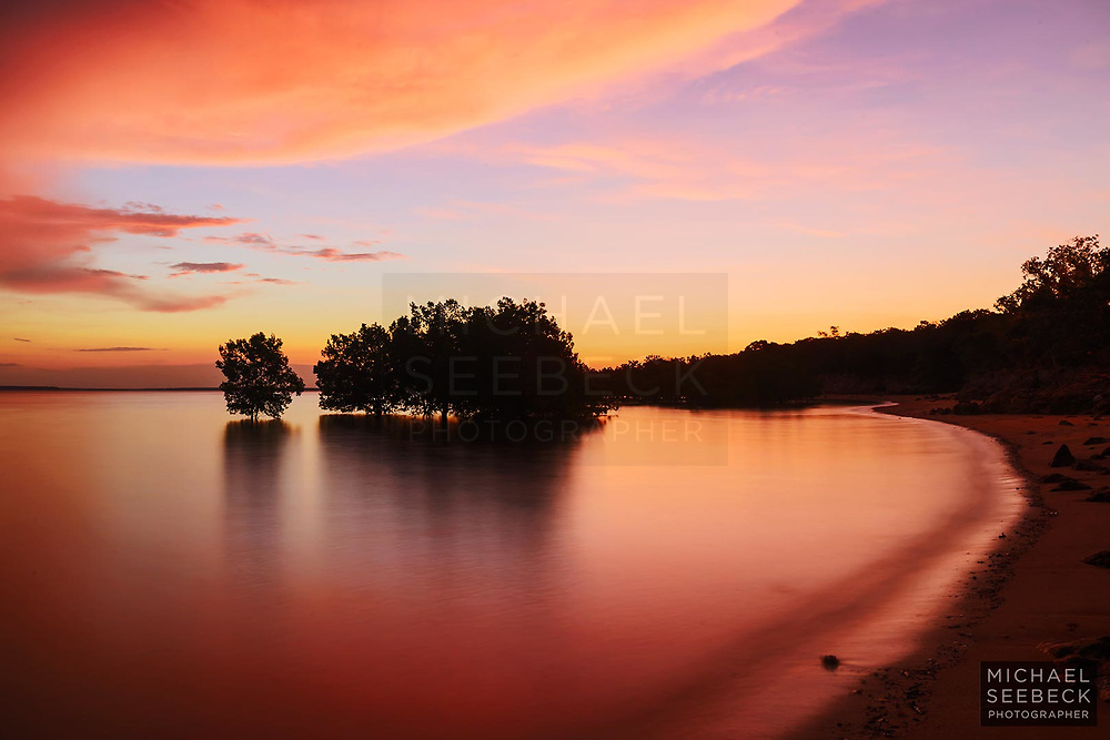 A beautiful sunset as viewed along the coastline of the Top End. <br /> <br /> I always get a little nervous in these kind of situations, near the water's edge, at dusk... Crocodiles...<br /> <br /> Code: LATD0012<br /> <br /> Limited Edition of 15 Prints